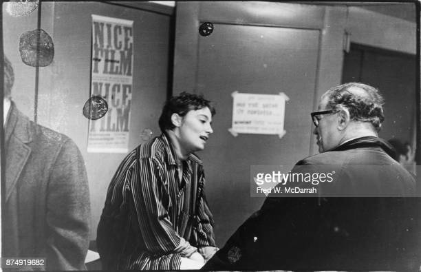 American film director and performance artist Barbara Rubin talks to an unidentified man at Filmmakers Cinematheque New York New York September 24...