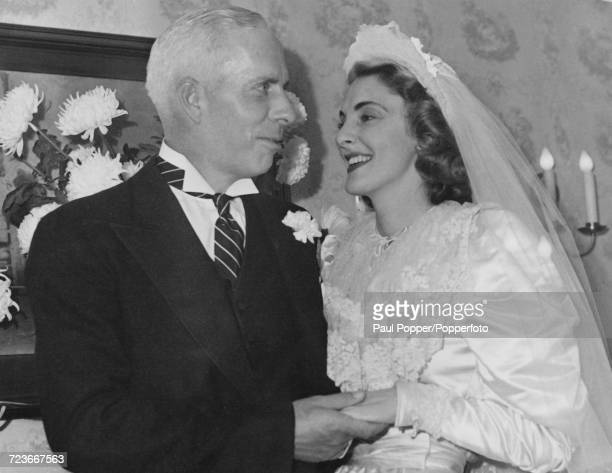 American film director and producer Howard Hawks pictured with his wife Slim Keith on their wedding day in Pasadena California on 10th December 1941
