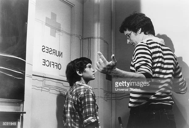 American film director and producer Steven Spielberg directs American actor Henry Thomas on the set of his film 'ET The ExtraTerrestrial' Spielberg...