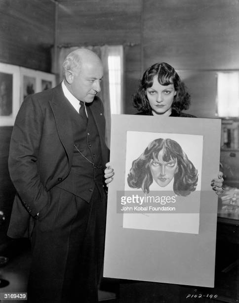 American film director Cecil B DeMille conducting a makeup test with Hedy Lamarr who plays Delilah in DeMille's 'Samson And Delilah' The makeup...