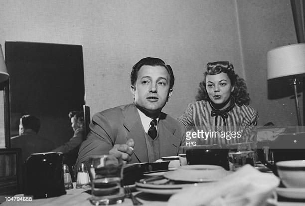 American film director Edward Dmytryk and his wife, actress Jean Porter, attend a press conference in New York City, May 1948. Dmytryk is one of the...