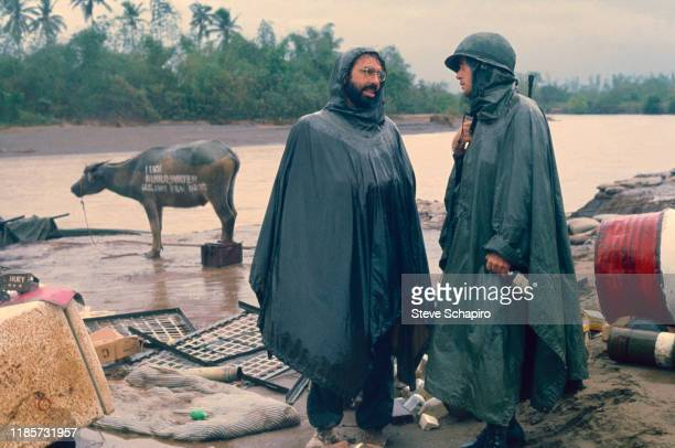 American film director Francis Ford Coppola speaks with actor Martin Sheen on the set of their film, 'Apocalypse Now' , Philippines, 1978. Behind...