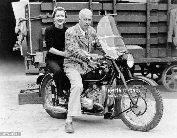 American film director Howard Hawks on a motorcycle at the Universal Studios lot 1943