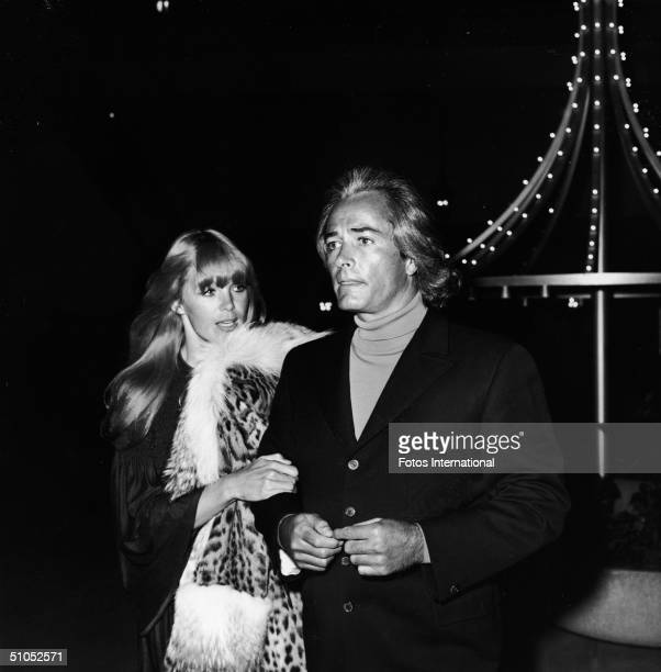American film director John Derek and his wife actor Linda Evans attend the opening night performance by Sonny and Cher at the Century Plaza Hotel...