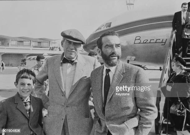 American film director John Huston and actor Montgomery Clift arrive at Vienna airport Austria for the filming of 'Freud The Secret Passion' in which...