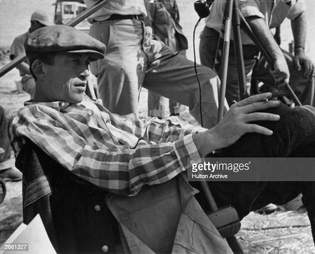 American film director John Huston on the set of his latest production the American Civil War drama 'The Red Badge of Courage'