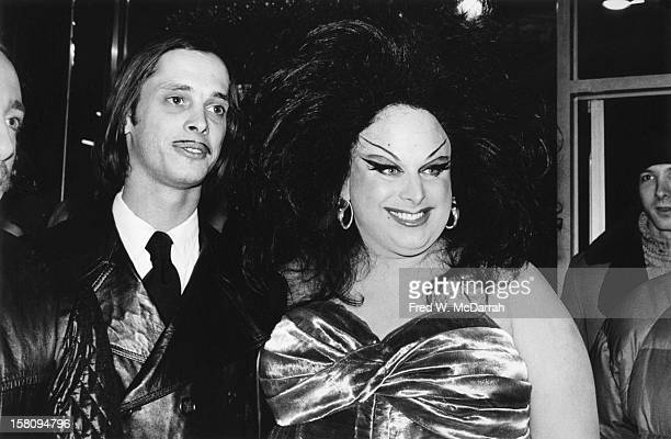 American film director John Waters and drag queen actor Divine attend the theatrical premiere of their film 'Female Trouble' New York New York...