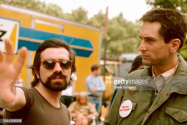 American film director Martin Scorsese gestures as he speaks with actor Robert De Niro on the set of their film 'Taxi Driver' New York New York 1975