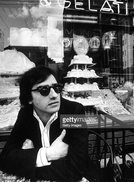 American film director Martin Scorsese sits in front of Ferrara's cafe on Mulberry Street in Little Italy, during the making of his film, 'Mean...