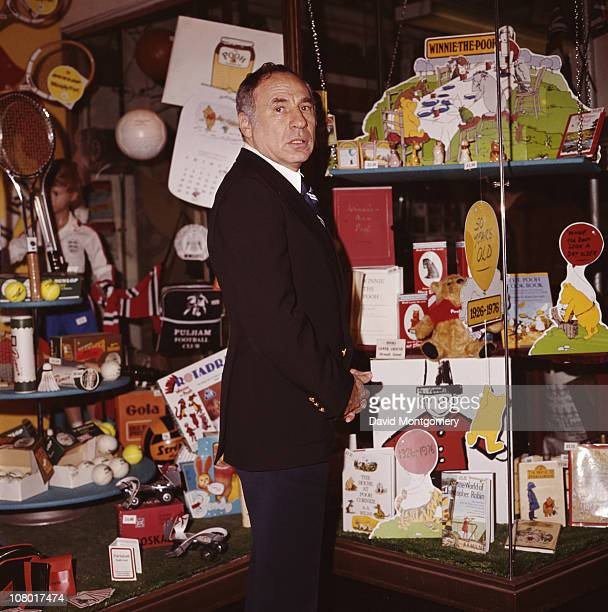 American film director Mel Brooks surrounded by children's toys December 1976