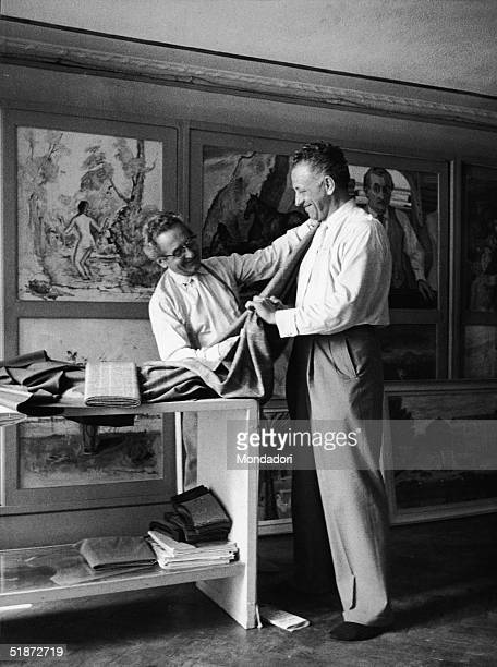 American film director Nicholas Ray is custom fitted by a tailor while in Venice for the Italian premiere of his film 'Amere Victoire' at the Venice...