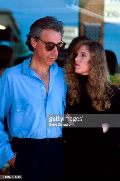 American film director Peter Bogdanovich and Canadian teenager Louise Hoogstraten talk together Los Angeles California 1985 The couple married three...