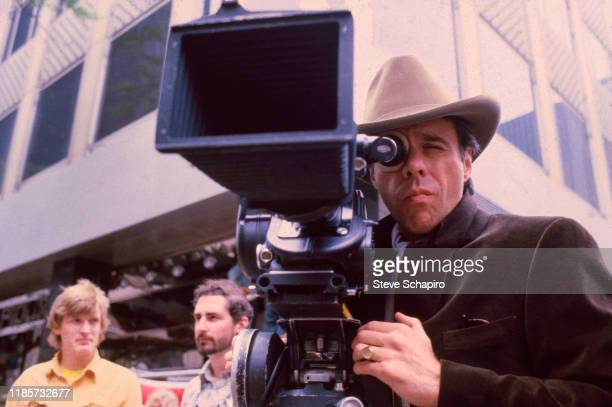 American film director Peter Bogdanovich looks though a camera on the set of his film 'They All Laughed' New York New York 1980