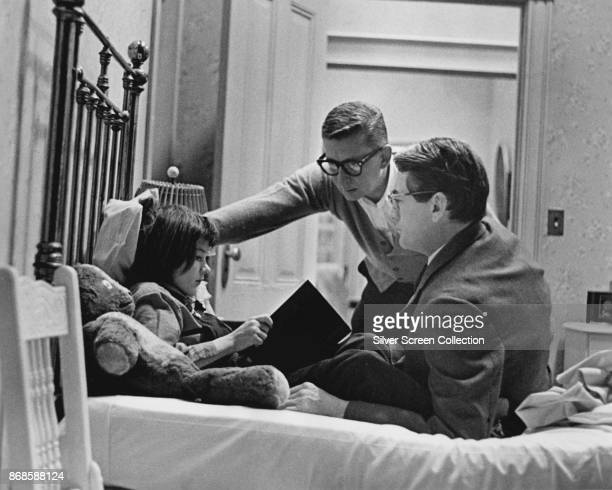 American film director Robert Mulligan talks with actors Mary Badham and Gregory Peck on the set of 'To Kill a Mockingbird' 1962