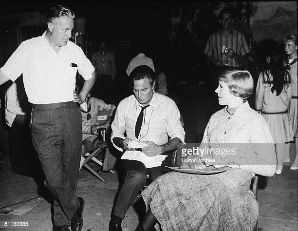 American film director Robert Wise Canadian actor Christopher Plummer and British actress Julie Andrews talk during a lunch break on the set of the...