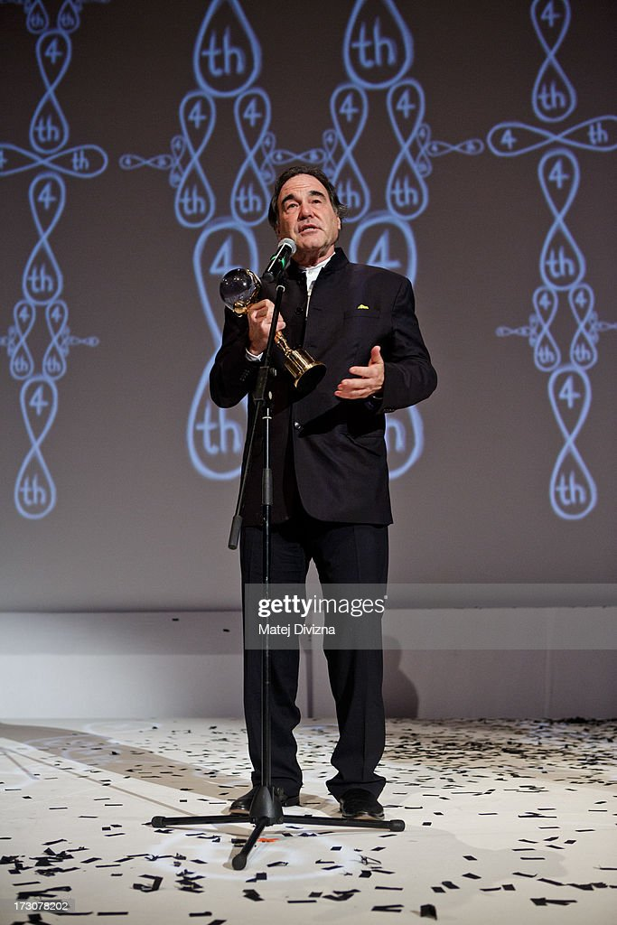 American film director, screenwriter, producer Oliver Stone holds the Crystal Globe for Outstanding Artistic Contribution to World Cinema at the closing ceremony of the 48th Karlovy Vary International Film Festival (KVIFF) on July 06, 2013 in Karlovy Vary, Czech Republic.