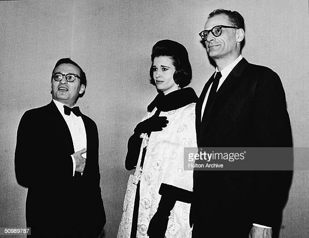 American film director Sidney Lumet stands with hand inside his tuxedo jacket pocket next to his second wife American heiress and designer Gloria...