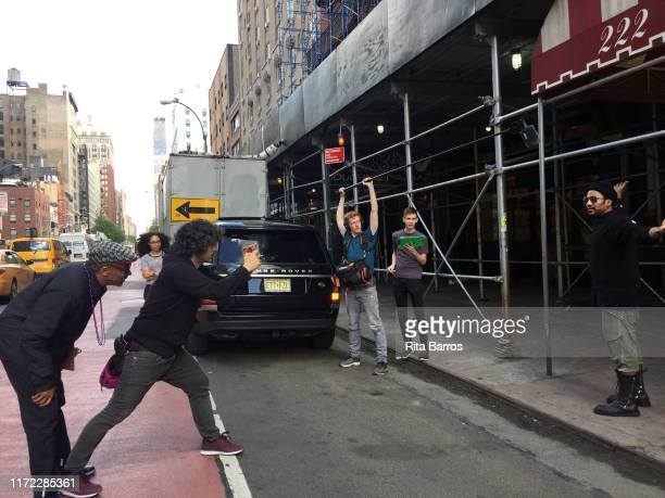 American film director Spike Lee and his crew film Rap musician and producer Q-Tip for a scene in front of the Chelsea Hotel , New York, New York,...