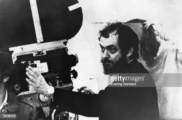 American film director Stanley Kubrick looking through a movie camera. Original Publication: People Disc - HG0039