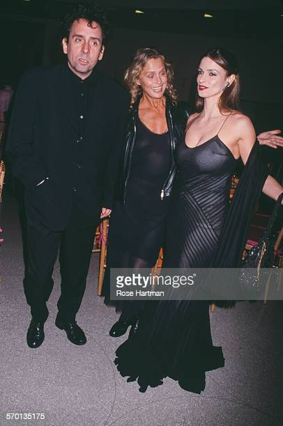 American film director Tim Burton with American actresses Lauren Hutton and Lisa Marie at the opening of the Francesco Clemente exhibition Solomon R...