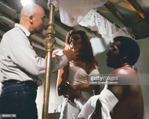 American film director Tom Gries talks with actors Raquel Welch and Jim Brown on the set of '100 Rifles' Spain 1969