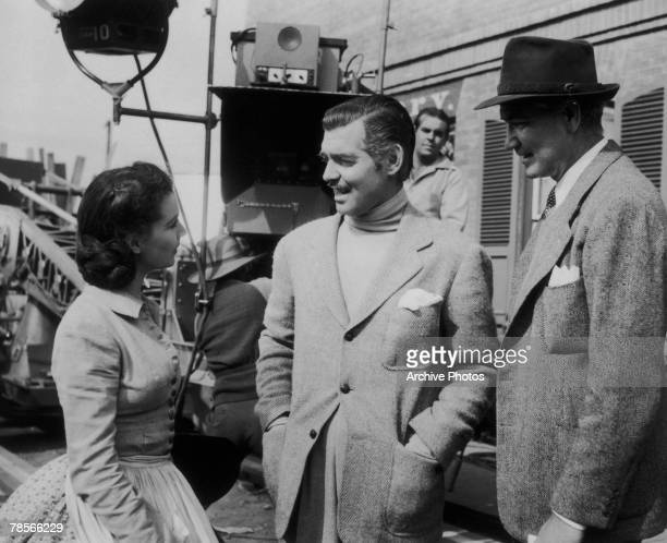 American film director Victor Fleming with actors Vivien Leigh and Clark Gable on the set of the film 'Gone With The Wind' 1939
