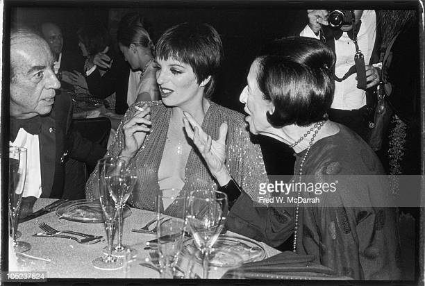 American film director Vincente Minnelli and his daughter singer and actress Liza Minnelli listen to Frenchborn American fashion editor Diana...