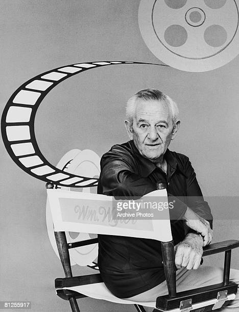 American film director William Wyler sitting in a director's chair circa 1975