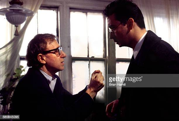 American film director Woody Allen talks with actor John Cusack on the set of their film 'Bullets Over Broadway' New York 1993