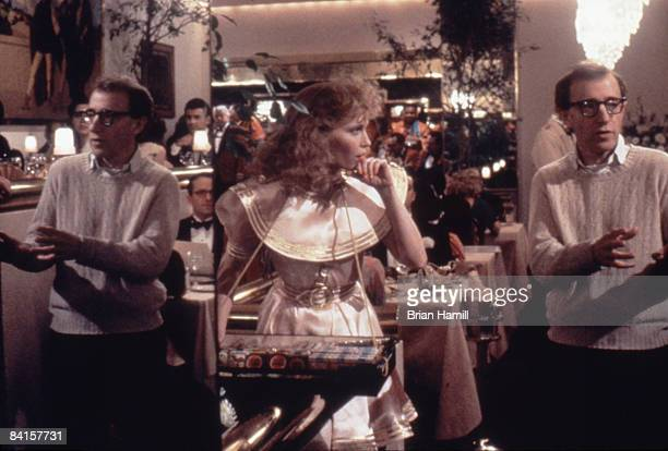 American film director Woody Allen talks with actress Mia Farrow who is dressed as a 'cigarette girl' on the set of the film 'Radio Days' New York...