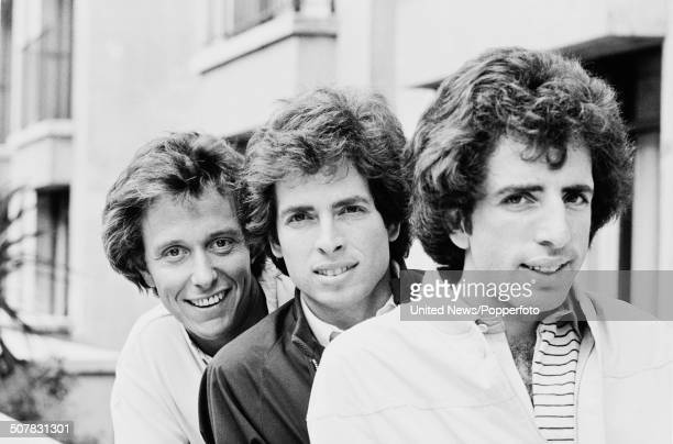 American film directors and writers of the film Airplane Jim Abrahams David Zucker and Jerry Zucker pose together in London on 6th August 1980