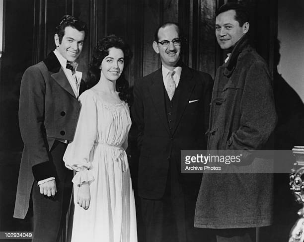 American film producer and director Roger Corman with actress Myrna Fahey and actor Mark Damon during the making of 'The Fall of the House of Usher'...