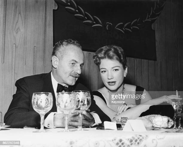 American film producer Darryl F Zanuck chats to actress Anne Baxter at a Hollywood banquet USA circa 1950