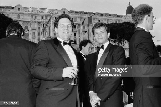American film producer Harvey Weinstein and others at the 1989 Cannes Film Festival, outside the InterContinental Carlton Cannes Hotel, Cannes,...