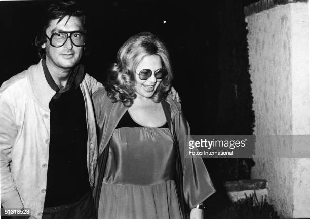 American film producer Robert Evans and his manager Sue Mengers arrive at The Backlot Room to see and hear singer Ellen March May 1979