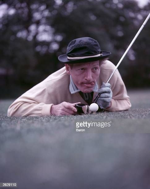 American film stage and television actor Danny Kaye lining up a shot on the golf course Original Publication People Disc HN0560
