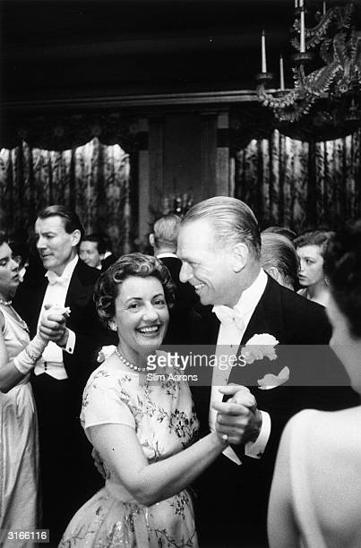 American film star Douglas Fairbanks Jnr and his wife Mary dancing at a debutante party held by Miss Frances Sweeney at Claridges Hotel in London