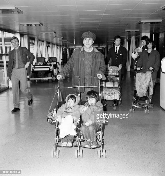 American film star Dustin Hoffman and his wife Lisa with their children Jake, aged 3, Rebecca, aged 1, and baby Max leaving Heathrow Airport for New...