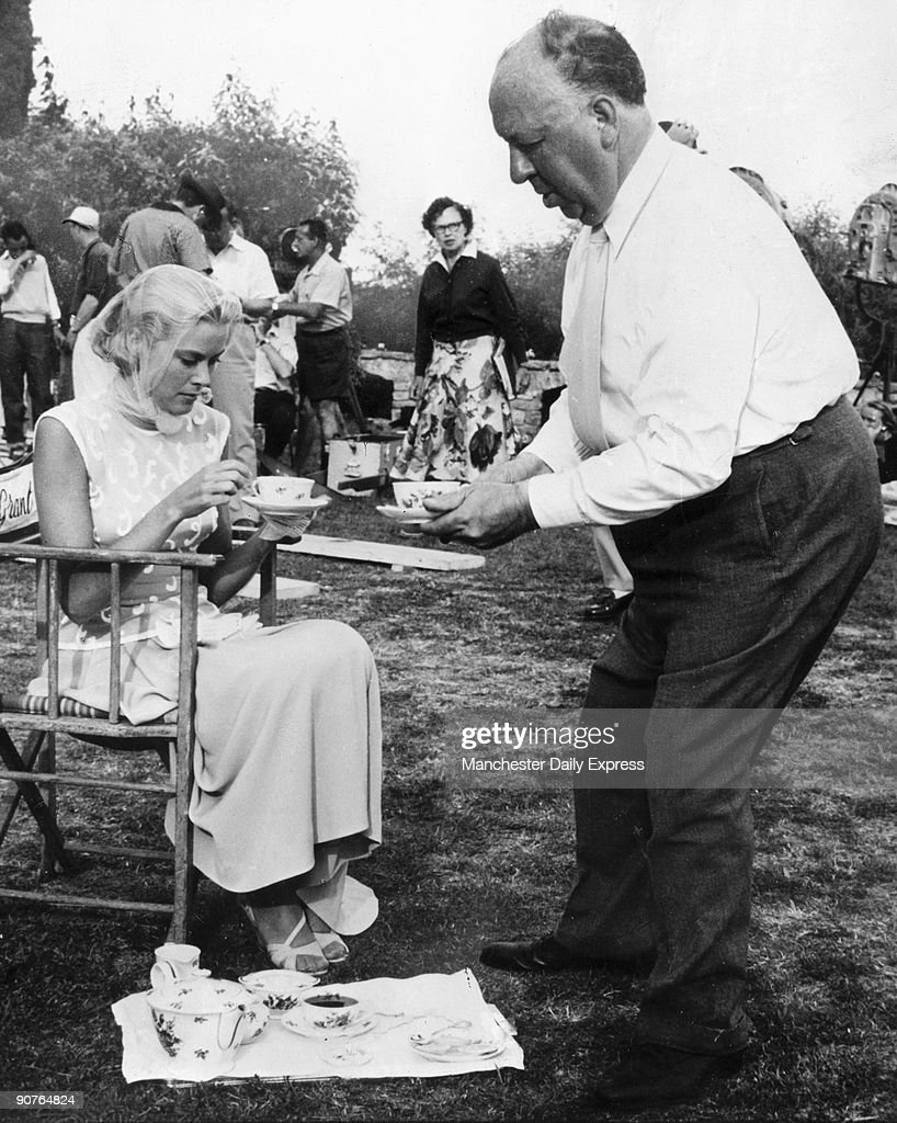 Grace Kelly and Alfred Hitchcock having tea, 1955. : News Photo