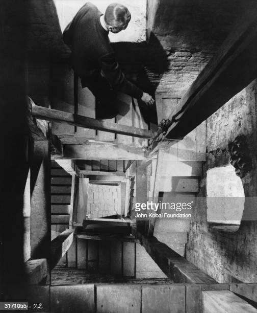 American film star James Stewart as detective Scottie Ferguson descending a spiral staircase in 'Vertigo' directed by Alfred Hitchcock