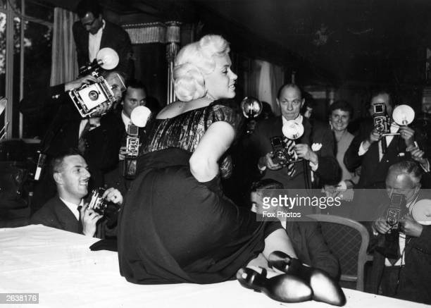 American film star Jayne Mansfield posing for photographers at the Dorchester Hotel London