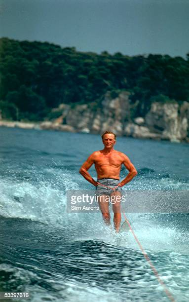 American film star Kirk Douglas water-skiing at the Eden Roc annex to the Hotel du Cap d'Antibes on the French Riviera, August 1969.