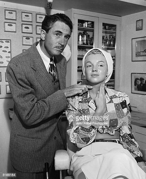 American film star Marilyn Monroe born Norma Jean Mortensen in Los Angeles begins the process of applying her makeup