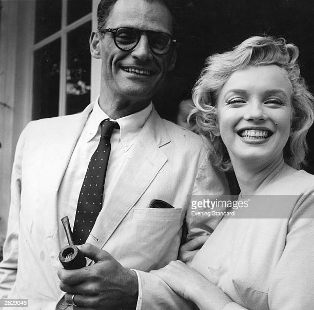 American film star Marilyn Monroe outside her home in Englefield Green with her third husband American playwright Arthur Miller Original Publication...