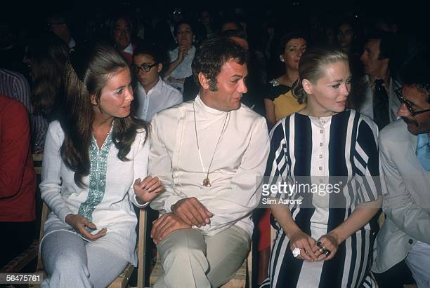 American film stars Tony Curtis and Faye Dunaway attend the Mare Moda festival on Capri, September 1968. On the left is Curtis' wife Leslie Allen.