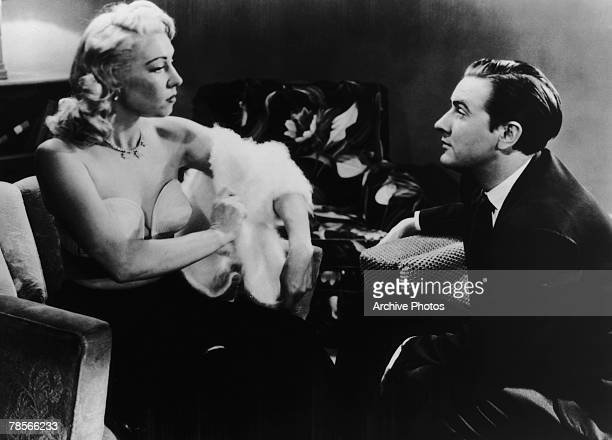 American filmmaker Edward D Wood Jr watches actress Dolores Fuller remove her white angora sweater in a still from the film 'Glen Or Glenda' 1953
