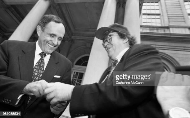 American filmmaker Michael Moore right and New York City Mayor Rudolph Giuliani outside City Hall during taping of an episode of Moore's NBC...