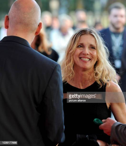 American filmmaker of the movie Miss Meadows Karen Leigh Hopkins is greeted by festival director Torsten Neumann  on the red carpet at the Oldenburg...
