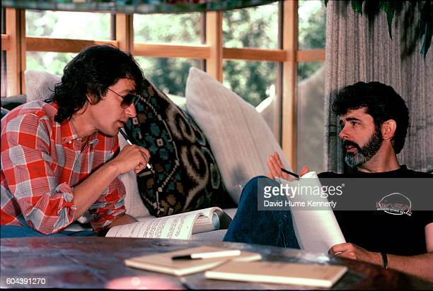 American filmmakers Steven Spielberg and George Lucas discuss an unspecified script in the offices of Amblin Entertainment on the Universal Studios...