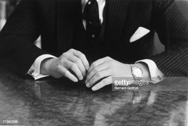 American financier David Rockefeller's hands are seen on a tabletop as he sits for a portrait 1967
